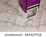 Small photo of Stamp on plan of house background. Finance and growth of business