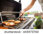 hand of young man grilling some ... | Shutterstock . vector #643473760