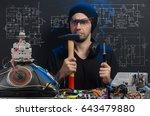 man is engaged in repair of... | Shutterstock . vector #643479880
