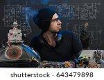 man is engaged in repair of... | Shutterstock . vector #643479898