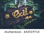 text exit on a wooden plate in... | Shutterstock . vector #643519714