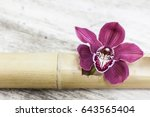 orchid flower and green leaves... | Shutterstock . vector #643565404