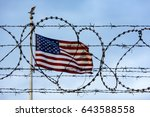 american flag and barbed wire ... | Shutterstock . vector #643588558
