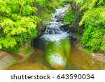 waterfall in the mountains | Shutterstock . vector #643590034