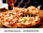 slice of hot pizza cheese lunch ... | Shutterstock . vector #643604296