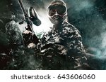 heavily armed masked paintball... | Shutterstock . vector #643606060