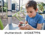 boy playing with fidget spinner.... | Shutterstock . vector #643687996