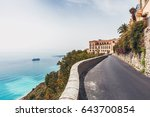 narrow mountain road leading to ... | Shutterstock . vector #643700854