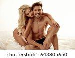 adorable blonde cuddling her...   Shutterstock . vector #643805650