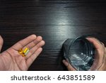 pouring capsules from a pills... | Shutterstock . vector #643851589