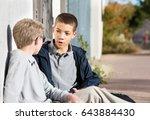 teen male talking to friend... | Shutterstock . vector #643884430