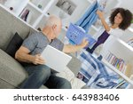 elderly man with young woman... | Shutterstock . vector #643983406