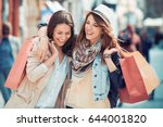 happy friends shopping. two... | Shutterstock . vector #644001820