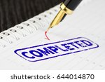 macro shot of completed stamp... | Shutterstock . vector #644014870