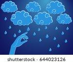 human hand touching a rain... | Shutterstock .eps vector #644023126