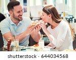 dating in pizzeria. handsome... | Shutterstock . vector #644034568