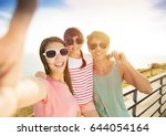 happy family  taking selfie  on ... | Shutterstock . vector #644054164
