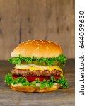 classic deluxe cheeseburger... | Shutterstock . vector #644059630