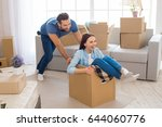 young couple moving to a new... | Shutterstock . vector #644060776