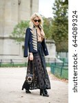 Small photo of PARIS-OCTOBER 1, 2016. Street style during Paris Fashion week. Ready to wear.