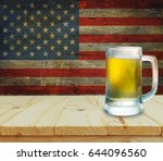 glass of beer on wooden table.... | Shutterstock . vector #644096560