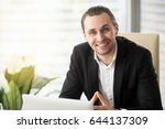 happy young businessman sitting ... | Shutterstock . vector #644137309