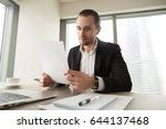 successful businessman examines ... | Shutterstock . vector #644137468