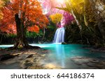 deep forest waterfall in autumn | Shutterstock . vector #644186374