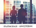 back view silhouettes of two... | Shutterstock . vector #644190844