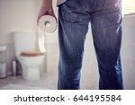 man holding toilet tissue roll... | Shutterstock . vector #644195584