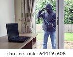 thief breaking into a house via ... | Shutterstock . vector #644195608