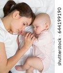 mother with newborn baby...   Shutterstock . vector #644199190