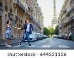 romantic couple running across...   Shutterstock . vector #644221126