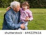 grandfather and granddaughter... | Shutterstock . vector #644229616