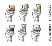 male hand holding a glass with... | Shutterstock .eps vector #644234110