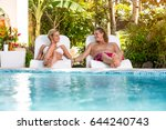 young couple sunbathing and... | Shutterstock . vector #644240743