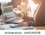 a business woman analyzing... | Shutterstock . vector #644244538