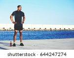 strong pumped body man resting... | Shutterstock . vector #644247274