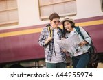 two asian tourists with... | Shutterstock . vector #644255974