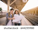two asian tourists with... | Shutterstock . vector #644255980