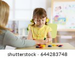 tutor and preschooler kid... | Shutterstock . vector #644283748