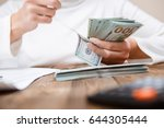 hands counting money  close up | Shutterstock . vector #644305444