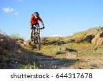 cyclist in red jacket riding... | Shutterstock . vector #644317678