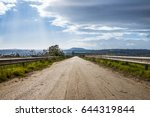 the road through the old field... | Shutterstock . vector #644319844