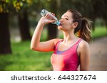 thirsty woman drinking water to ... | Shutterstock . vector #644327674
