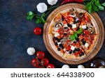 hot testy pizza with tomatoes ... | Shutterstock . vector #644338900