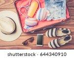open bag with beach accessories ... | Shutterstock . vector #644340910