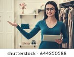 beautiful female shop assistant ... | Shutterstock . vector #644350588