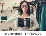 attractive female shop... | Shutterstock . vector #644364130