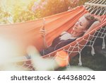 summer day  young woman lying... | Shutterstock . vector #644368024